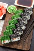 Sushi roll covered with dill and sesame — Foto Stock