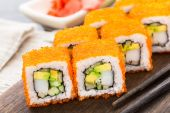Sushi roll with tobico and avocado — Stock Photo