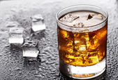 Glass with alcoholic drink — Stock Photo