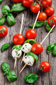 Skewers with tomato, basil and mozarella — Stock Photo