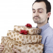 Young man holding a present — Stock Photo #52283339