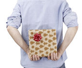 Young man holding a present — Stock Photo
