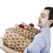 Young man holding a present — Stock Photo #59952461