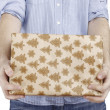 Young man holding a present — Stock Photo #63053367