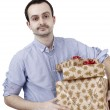 Young man holding a present — Stock Photo #63053561