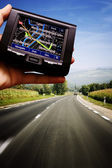 GPS in a man hand — Stock Photo