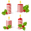 Christmas candles with holly leaves — Stock Vector #54967953