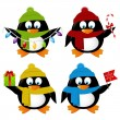 Xmas penguins — Stock Vector #60662107
