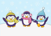 Cute penguins on snow — Stock Vector