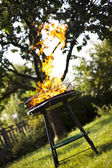 Super flames on the grill — Stock Photo