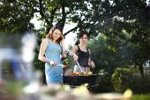 Girls making food on grill — Stock Photo