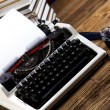Retro typewriter, feather and ink — Stock Photo #52073855
