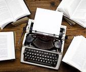 Retro typewriter with old books — Stock Photo