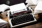 Typewriter with books — Stock Photo