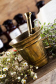 Herbal medicine and book — Stock Photo