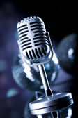Microphone with disco balls — Stock Photo