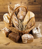 Composition with breads and basket — Stock Photo