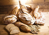 Traditional bread in wicker basket — Stock Photo