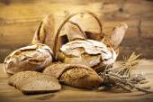 Traditional bread in wicker basket — Stock Photo