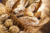 Baked breads in basket — Photo