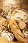 Baked breads in basket — Stock Photo