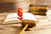 Law book, scales with mallet of judge — Stock Photo