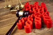 Wooden gavel and paragraph signs — Stock Photo