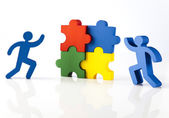 Figures with colorful puzzle pieces — Stock Photo
