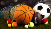 Sport balls with rackets — Stock Photo