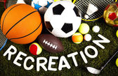 Recreation word with sports equipment — Stock Photo