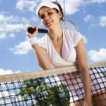 Woman holding tennis ball — Stock Photo #52117995
