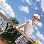 Woman holding tennis ball — Stock Photo #52118033