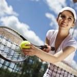 Woman holding tennis ball — Stock Photo #52119729