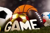 Game word around sport equipment — Stock Photo