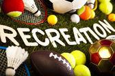 Palabra de recreación con equipamiento deportivo — Foto de Stock