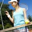 Girl rests on a tennis net — Stock Photo #52121215