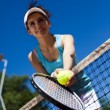 Girl rests on a tennis net — Stock Photo #52121949