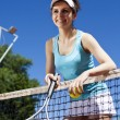 Girl rests on a tennis net — Stock Photo #52122267