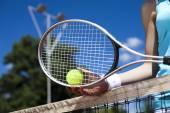 Woman holding tennis balls — Stock Photo