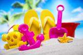 Flip flops with toys — Stock Photo