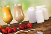 Fruits and protein shakes — Stock Photo