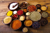Spices on wooden bowls — Stock Photo