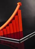 компьютерная таблетка с финансовым графом — Стоковое фото