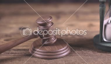 Gavel with Paragraphs sign and hourglass — Stock Video