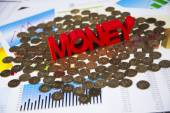 Red money word on coins heap — Stock Photo
