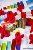 Financial graph from coins with percent signs — Stock Photo