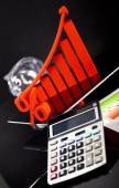 Financial graph on tablet with calculator — Stock Photo