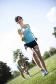 Women jogging on green grass — Stock Photo