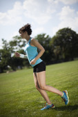 Young fitness woman running — Stock Photo
