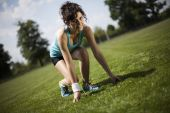 Young woman preparing to jogging — Stock Photo
